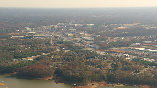 WS AERIAL View of city with Anderson and shopping malls and parking area / South Carolina, United States