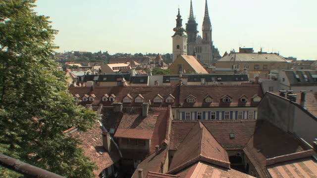 ws view of city with cathedral in distance / zagreb, croatia  - zagreb stock videos and b-roll footage