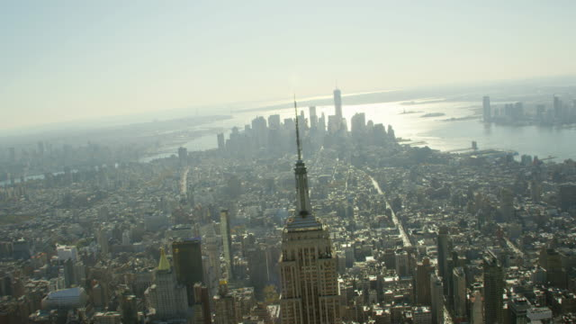 WS AERIAL View of city with empire state building and one trade center on distance / New York City