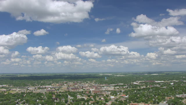 WS AERIAL POV View of city with farmland in background / Waterloo, Iowa, United States