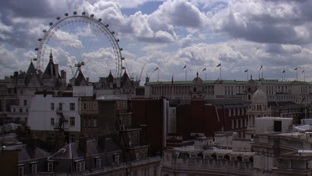 ws view of city with flags and london eye / london, uk - big wheel stock videos & royalty-free footage