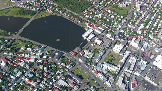 MS AERIAL TD View of city with lake at Oskjuhlid / Iceland
