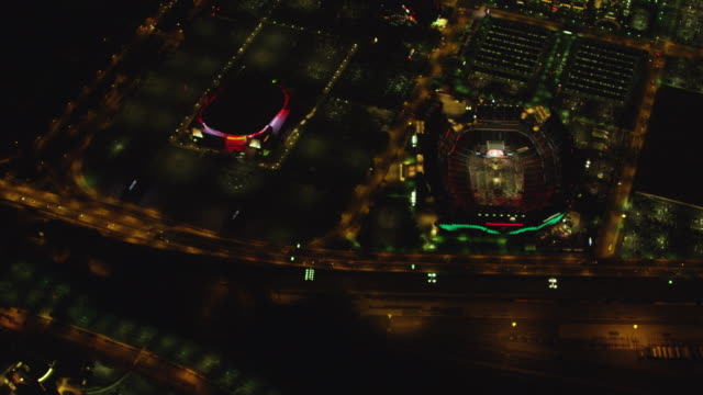 MS AERIAL View of city with Lincoln financial field and citizen bank park at night / Philadelphia