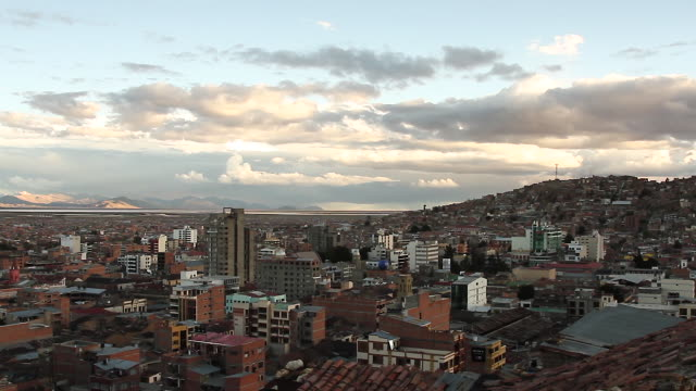 view of city with mountain in background / oruro, bolivia - ボリビア点の映像素材/bロール