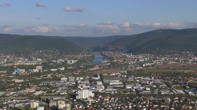 ws aerial view of city with river and mountain / heidelberg, baden wurttemberg - heidelberg germany stock videos & royalty-free footage