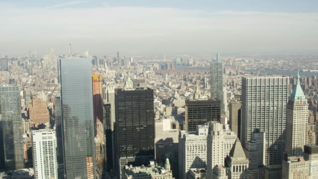 WS AERIAL View of city with skyscrapers and east river on distance/ New York City