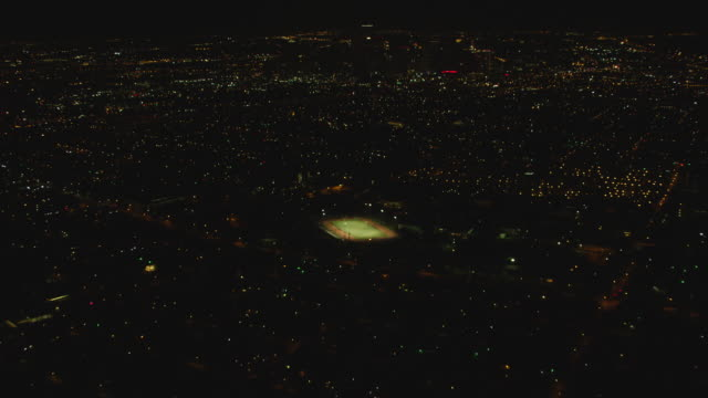 ws aerial view of city with tdecu stadium at night / houston - aircraft point of view stock videos & royalty-free footage