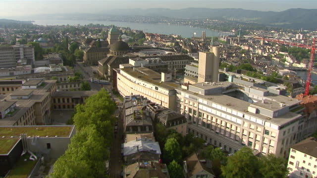 ws aerial view of city with university and swiss federal institute of technology / zurich city, zurich, switzerland - switzerland点の映像素材/bロール