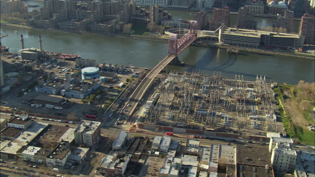 ws pan aerial view of cityscape and bridge with power plant / new york city, new york, usa - equipment stock videos & royalty-free footage