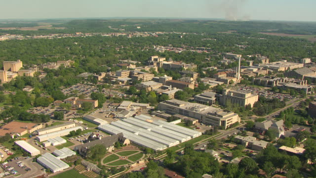 ws aerial ds view of cityscape at kansas state university / manhattan, kansas, united states - kansas stock videos and b-roll footage