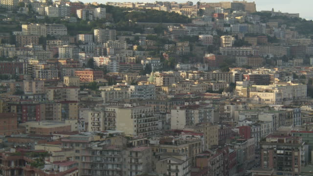 ws view of cityscape at sunrise / naples, campania, italy - ナポリ点の映像素材/bロール