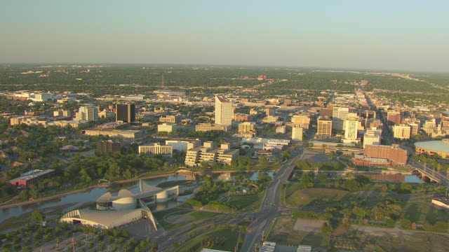 ws aerial view of cityscape at sunset / wichita, kansas, united states - wichita stock-videos und b-roll-filmmaterial
