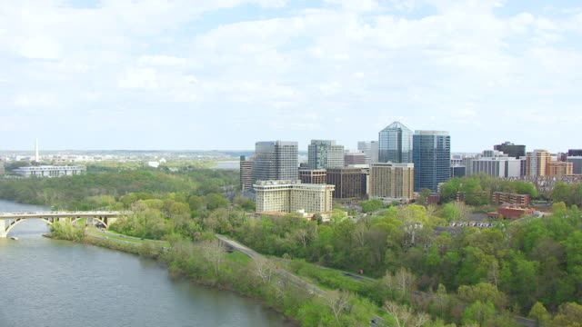 ws aerial pov view of cityscape, bridge on potomac river / rosslyn, arlington county, virginia, united states - arlington virginia video stock e b–roll