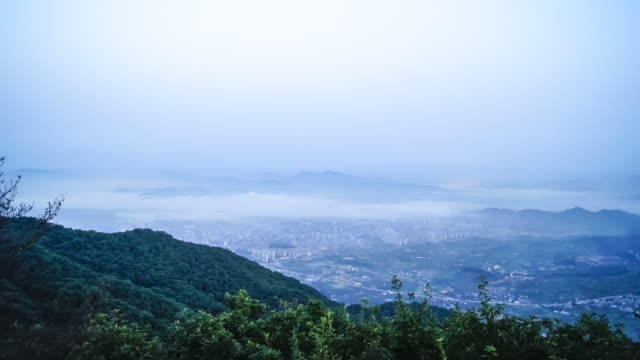 ws t/l ha view of cityscape in chungju with fog from mountain / chungju, chungcheongbuk do, south korea - furzen stock-videos und b-roll-filmmaterial