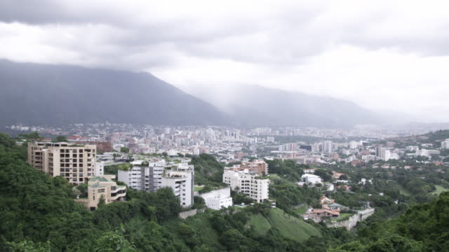 WS View of cityscape located near mountain / Caracas, Venezuela