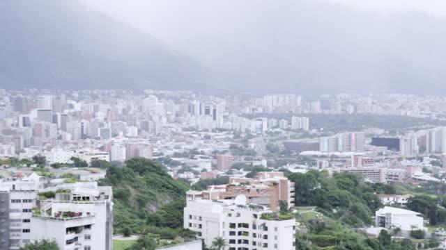 WS PAN View of cityscape located near mountain / Caracas, Venezuela