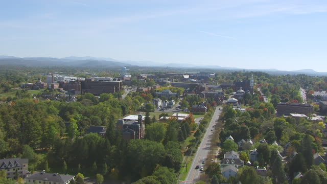 WS AERIAL POV View of cityscape, mountain in background / Burlington, Vermont, United States