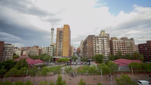 ws t/l view of cityscape of hillbrow with hillbrow tower shot from constitution hill at dusk / johannesburg, gauteng, south africa  - constitution stock videos and b-roll footage