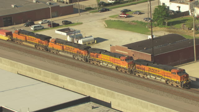 ms aerial zo view of cityscape with bnsf goods train moving on track / wichita, kansas, united states - wichita stock-videos und b-roll-filmmaterial