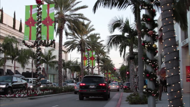 ws view of cityscape with christmas lights on rodeo drive / beverly hills, california, usa - beverly hills california stock videos and b-roll footage