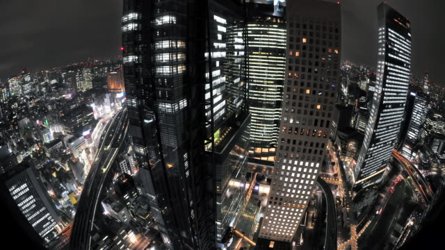 WS T/L HA View of cityscape with elevators moving up and down skyscrapers and busy streets below Shiodome / Tokyo, Japan