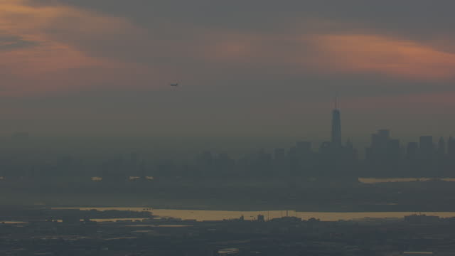 WS TS AERIAL POV View of cityscape with financial district and freedom tower at sunrise / New York City, Lower Manhattan, New York State, United States