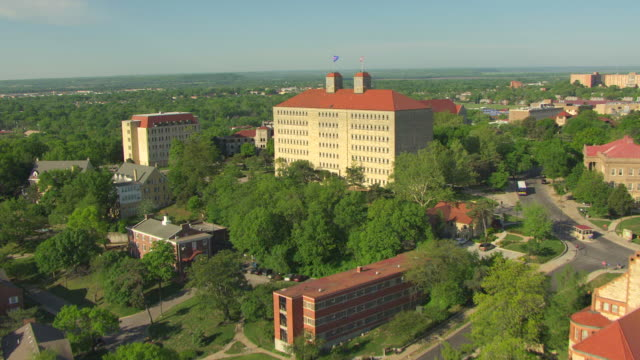 ms aerial view of cityscape with flyover university of kansas campus buildings / lawrence, kansas, united states - kansas stock videos and b-roll footage