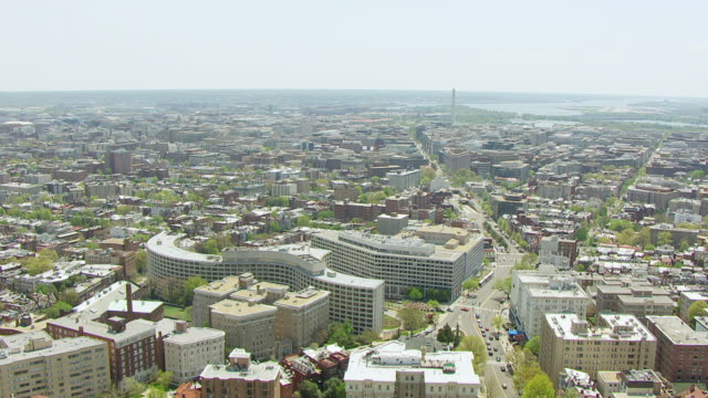 WS AERIAL POV View of cityscape with Hilton Hotel and Dupont Circle / Washington DC, United States