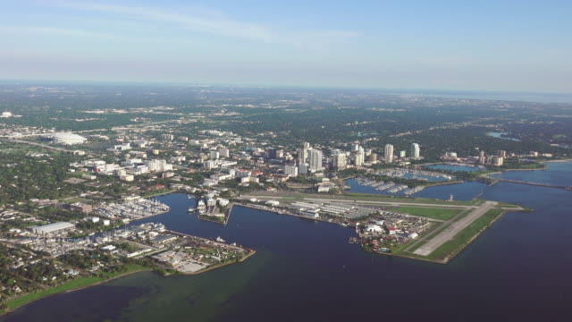 WS AERIAL POV View of cityscape with horizon in background / St. Petersburg, Florida, United States