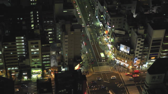 ws view of cityscape with intersection / hamamatsu-cho, tokyo, japan - hamamatsu stock videos and b-roll footage