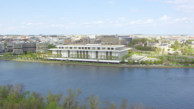 ws aerial pov view of cityscape with kennedy center, potomac river in foreground / washington dc, united states - john f. kennedy center for the performing arts stock videos and b-roll footage