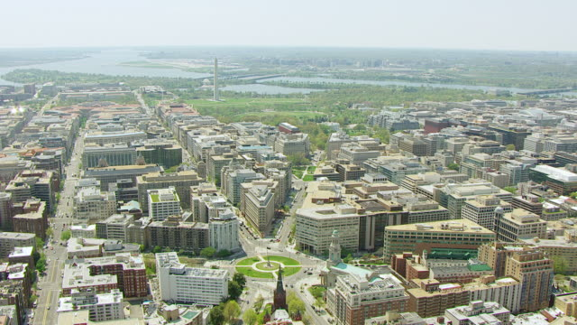 ws aerial pov view of cityscape with logan circle and washington monument, potomac river in background / washington dc, united states - logan circle stock videos and b-roll footage