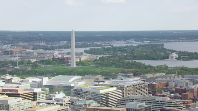 ws aerial pov view of cityscape with washington monument and jefferson memorial in background / washington dc, united states  - jefferson memorial stock videos and b-roll footage
