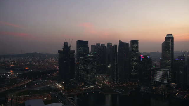 WS View of cityscapes roof of skypark and buildings across bay at sunset time / Singapore