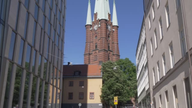stockvideo's en b-roll-footage met view of clara kyrkas vanner church and clock tower spire, stockholm, sweden, scandinavia, europe - torenspits