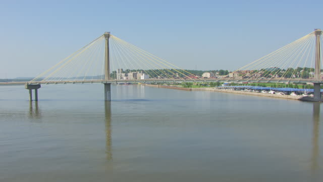 WS AERIAL POV View of Clark Bridge with Mississippi River, city in background / Alton, Illinois, United States