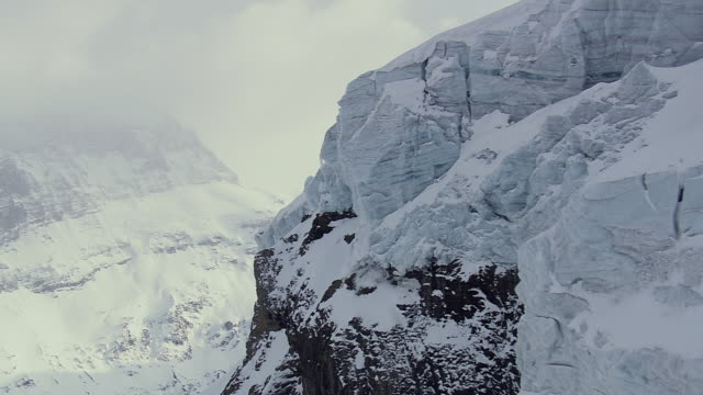 WS AERIAL View of Cliff of ice / Switzerland