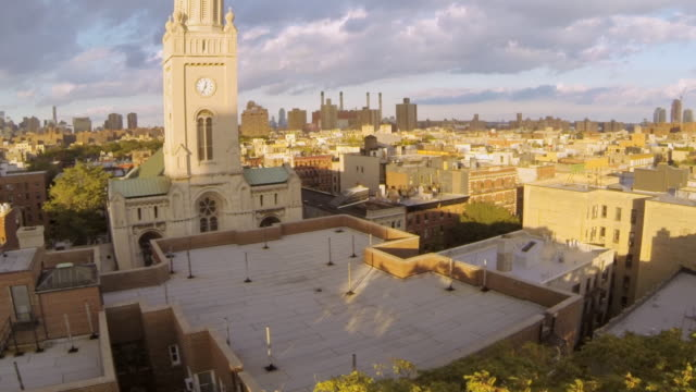 WS AERIAL SLO MO View of clock church tower revealing city skyline / New York, United States
