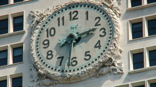 cu view of clock on the woolworth building / new york city, new york state, usa  - turmuhr stock-videos und b-roll-filmmaterial