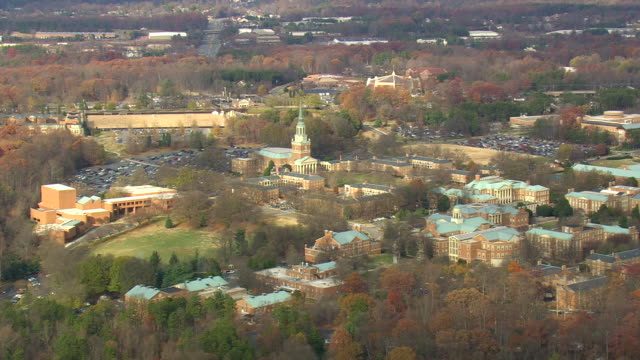 WS AERIAL View of clock tower with Old Salem at Winston Salem / North Carolina, United States