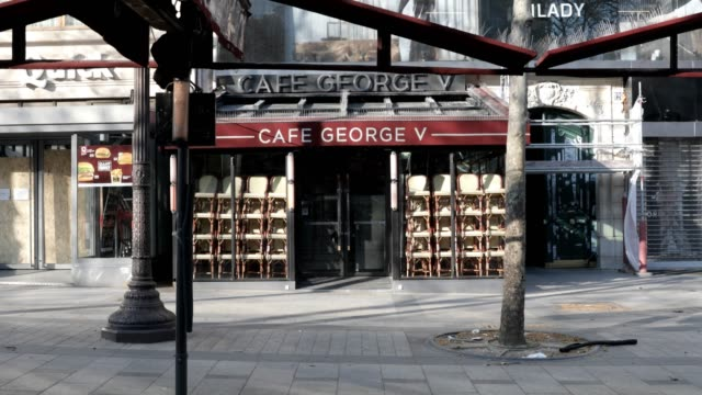 view of closed restaurants on the champsélysées during the coronavirus pandemic on march 31 2020 in paris france france is issuing fines to people... - french restaurant stock videos & royalty-free footage
