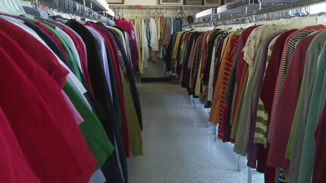 ws pan view of clothing racks in thrift store / morris, illinois, usa - second hand stock videos & royalty-free footage