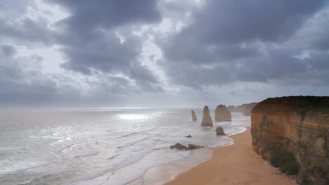 WS View of Cloud fast moving storm passing above Twelve Apostles at dusk / Port Campbell, Victoria, Australia