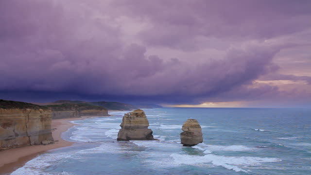 ws view of cloud fast moving storm passing above twelve apostles at dusk / port campbell, victoria, australia - port campbell national park stock videos & royalty-free footage