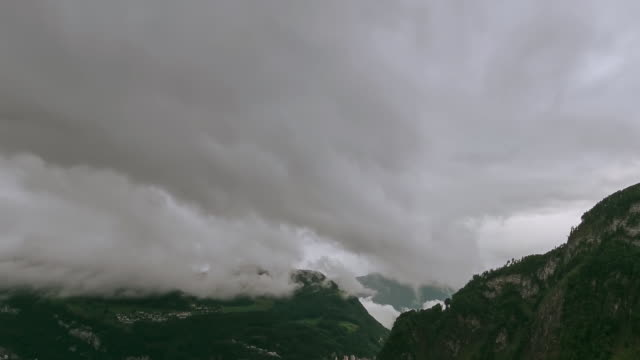 WS ZO T/L View of Cloud sea at Lake Lucerne with village, in distance / Lucerne, Switzerland