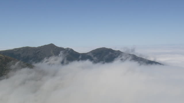 MS AERIAL View of clouds above Mount Washington / New Hampshire, United States