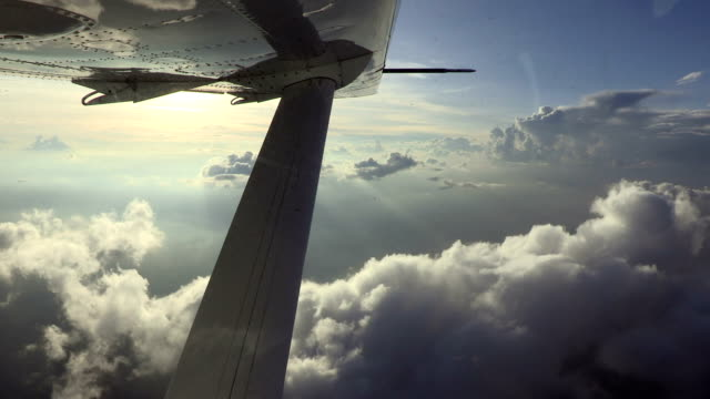 View of clouds and sky of the underwing of a Cessna 208 Caravan
