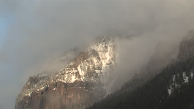 ws view of clouds and snow rolling over majestic mountain peaks in evening light / telluride, colorado, united states - majestic stock videos & royalty-free footage