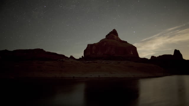 ws t/l view of clouds and stars passing over mountains / lake powell, utah, usa - rock formation stock videos & royalty-free footage