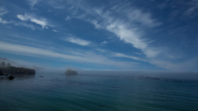 ws t/l view of clouds moving in sky over pacific ocean / mendocino, california, united states - horizont stock-videos und b-roll-filmmaterial